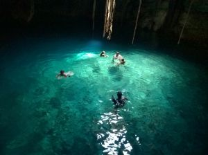 People swiming in undeground cenote