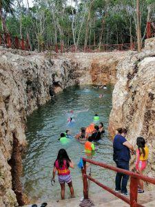 children swiming at cenote koleeb caab