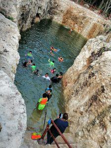 people swimin at cenote koleeb caab