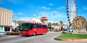 Red bus for public transportation in Cancún